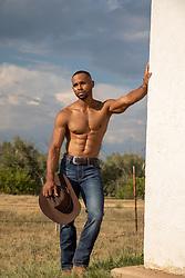 hot shirtless muscular cowboy on a ranch