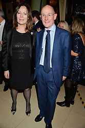 CHRISTOPHER ROGERS MD of Costa and author ROSE TREMAIN at the Costa Book Awards 2013 held at Quaglino's, 16 Bury Street, London on 28th January 2014.