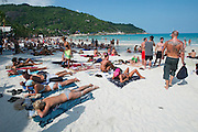 The notorious Full Moon Party at Hat Rin beach on the small Thai island of Ko Pha-Ngan is Asia's biggest regular rave event..Ravers waiting for the Moonrise at the beach.