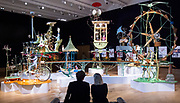 Bonham's Auction of kinetic sculpture <br /> 'A Quiet Afternoon in the Cloud Cuckoo Valley' by Rowland Emett. <br /> Press photo call <br /> 12th August 2019 <br /> At Bonhams, New Bond Street, London, Great Britain <br /> <br /> It will be displayed at Bonhams from 12 August to 3 September, 2019. Admission free. Open Monday to Friday, 9am-4.30pm<br /> It will then be offered in a stand-alone auction at Bonhams on 3 September at 1pm. The sculpture is expected to attract a six-figure sum.<br /> <br /> Rowland Emett, the British artist and inventor most famous for his magical flying car and the crackpot machines made for the film, Chitty Chitty Bang Bang<br /> <br /> <br /> Tim Griffiths, president of the Rowland Emett Appreciation Society<br /> <br /> Claire Tole-Moir<br /> Bonhams Entertainment Memorabilia specialist<br />  <br /> A Quiet Afternoon in the Cloud Cuckoo Valley tells the story of a pleasure trip on the Far Tottering and Oyster Creek Railway.<br />  <br /> Photograph by Elliott franks