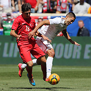 Clint Dempsey, (right), USA, in action against Ozan Tufan, Turkey, during the US Men's National Team Vs Turkey friendly match at Red Bull Arena.  The game was part of the USA teams three-game send-off series in preparation for the 2014 FIFA World Cup in Brazil. Red Bull Arena, Harrison, New Jersey. USA. 1st June 2014. Photo Tim Clayton