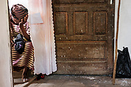A woman waits for treatment on the first day of the LCMS Mercy Medical Team on Monday, May 7, 2018, in the Yardu village outside Koidu, Sierra Leone, West Africa. LCMS Communications/Erik M. Lunsford
