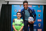 AFC Wimbledon goalkeeper Nathan Trott (1) and Mascot during the EFL Sky Bet League 1 match between AFC Wimbledon and Portsmouth at the Cherry Red Records Stadium, Kingston, England on 19 October 2019.
