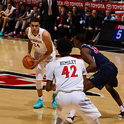 17 January 2018: San Diego State Aztecs forward Nolan Narain (24) looks to pass the ball while being defended by  Fresno State Bulldogs forward Nate Grimes (32) in the first half. San Diego State leads Fresno State 40-36 at halftime at Viejas Arena. <br /> More game action at www.sdsuaztecphotos.com