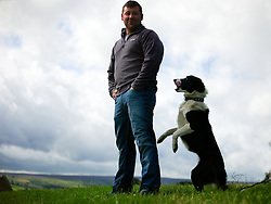 © Licensed to London News Pictures.26/08/15<br /> Egton, UK. <br /> <br /> Ben Smith from Northumberland and his sheepdog also called Ben wait to compete in the sheep dog trials at the 126th Egton Show in North Yorkshire. <br /> <br /> Egton is one of the largest village shows in the country and is run by a band of voluntary helpers. <br /> <br /> This year the event featured wrought iron and farrier displays, a farmers market, plus horse, cattle, sheep, goat, ferret, fur and feather classes. There was also bee keeping, produce and handicrafts on display.<br /> <br /> Photo credit : Ian Forsyth/LNP