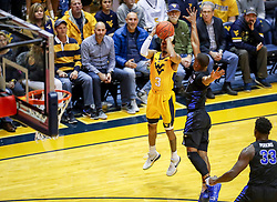Nov 9, 2018; Morgantown, WV, USA; West Virginia Mountaineers guard James Bolden (3) shoots a three pointer during the first half against the Buffalo Bulls at WVU Coliseum. Mandatory Credit: Ben Queen-USA TODAY Sports