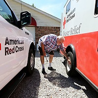 Joe Lukas, Red Cross Board Member and Director of Operations Services, checks the tire pressure on the Disaster Relief Vehicle, ERV 1138, as he goes through a check list for the truck to have it ready in case it is needed once Hurricane Florence hits the east coast.