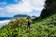 Woman trekkinh on Ofu Island, Manu´a island group, American Samoa, South Pacific, MR