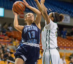 Spring Valley guard Sarah Kelly (13) shoots while Huntington guard Dazha Congleton (15) defends during a first round game at the Charleston Civic Center.