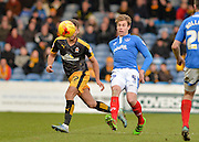Portsmouth defender Adam Webster makes a clearance ahead of Cambridge United Forward Ben Williamson during the Sky Bet League 2 match between Portsmouth and Cambridge United at Fratton Park, Portsmouth, England on 27 February 2016. Photo by Adam Rivers.