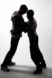 Teenage boys fighting,