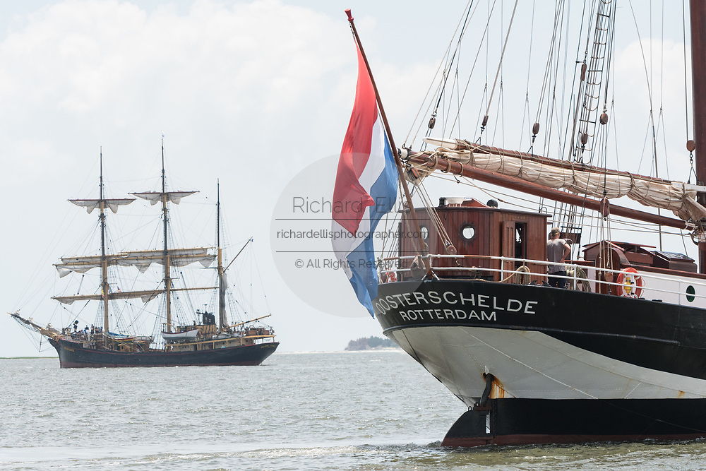 The Dutch three-masted schooner Oosterschelde, right, passes the Canadian three-masted Barque Picton Castle, left, during the parade of sails kicking off the Tall Ships Charleston festival May 18, 2017 in Charleston, South Carolina. The festival of tall sailing ships from around the world will spend three-days visiting historic Charleston.