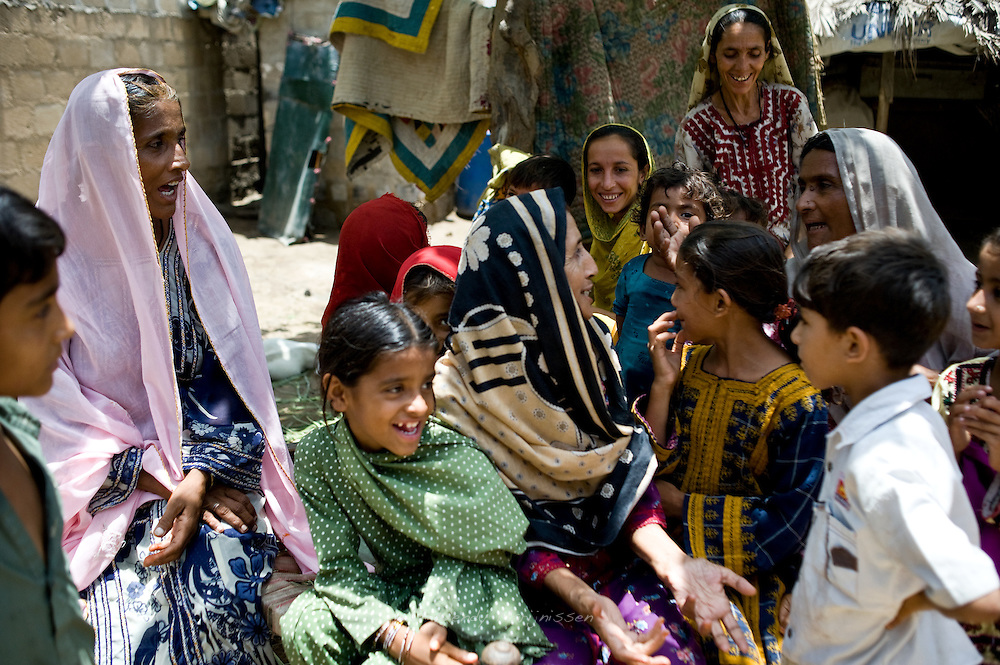 A family member making a family visit to Mirzada's home shares the latest gossip with her family members. <br />