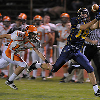 JC Grim (18) pulls in a pass over his shoulder near the 30-yard line to score a touchdown during the second quarter against Sprague in Bend on Friday.