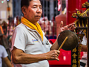 04 OCTOBER 2016 - BANGKOK, THAILAND:  A Thai Chinese man participates in a traditional cymbal playing circle in front of the Chinese opera stage at the Vegetarian Festival at the Chit Sia Ma Chinese shrine in Bangkok. The Vegetarian Festival is celebrated throughout Thailand. It is the Thai version of the The Nine Emperor Gods Festival, a nine-day Taoist celebration beginning on the eve of 9th lunar month of the Chinese calendar. During a period of nine days, those who are participating in the festival dress all in white and abstain from eating meat, poultry, seafood, and dairy products. Vendors and proprietors of restaurants indicate that vegetarian food is for sale by putting a yellow flag out with Thai characters for meatless written on it in red.    PHOTO BY JACK KURTZ