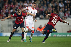 23.10.2012, Grand Stade Lille Metropole, Lille, OSC Lille vs FC Bayern Muenchen, im Bild vlnr - Lucas DIGNE (OSC Lille - 03) - Mario MANDZUKIC (FC Bayern Muenchen - 9) - Franck BERIA (OSC Lille - 18) // during UEFA Championsleague Match between Lille OSC and FC Bayern Munich at the Grand Stade Lille Metropole, Lille, France on 2012/10/23. EXPA Pictures © 2012, PhotoCredit: EXPA/ Eibner/ Gerry Schmit..***** ATTENTION - OUT OF GER *****