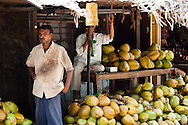 A man standing in front of his fruit stall in Bangalore India