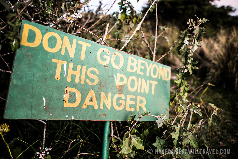 A sign warning of danger at the Simba Campsite on the rim of Ngorongoro Crater in the Ngorongoro Conservation Area, part of Tanzania's northern circuit of national parks and nature preserves.