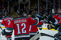 KELOWNA, CANADA - OCTOBER 13: Erik Gardiner #12 of the Kelowna Rockets skates past the bench and high fives teammates to celebrate a goal against the Calgary Hitmen on October 13, 2017 at Prospera Place in Kelowna, British Columbia, Canada.  (Photo by Marissa Baecker/Shoot the Breeze)  *** Local Caption ***