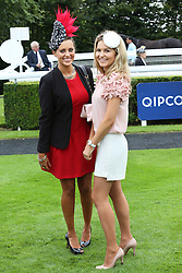 Camilla Henderson, the daughter of trainer Nicky Henderson (left) and Milliner Cara Meechan in the parade ring on the second day of Glorious Goodwood<br /> London,  Wednesday, 31st July 2013<br /> Picture by Stephen Lock / i-Images