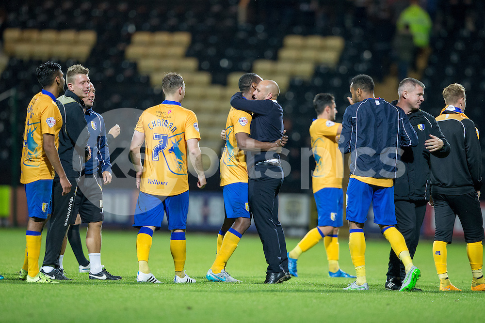 Adam Murray and his Mansfield Side celebrate their derby win over Notts County during the Sky Bet League 2 match between Notts County and Mansfield Town at Meadow Lane, Nottingham, England on 14 August 2015. Photo by James Williamson.