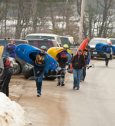 "A group of kayakers carry their boats to the ""put in"" area for the 30th annual New Year's Winnipesaukee kayak run on Saturday, January 1, 2011.  (Alan MacRae/for the Monitor)"