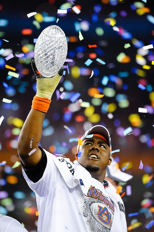 GLENDALE, AZ - JANUARY 10: Nick Fairley #90 of the Auburn Tigers holds up the Championship Trophy after defeating the Oregon Ducks in the Tostitos BCS National Championship Game at University of Phoenix Stadium on January 10, 2011 in Glendale, Arizona. ( Photo by: Rob Tringali) *** Local Caption *** Nick Fairley