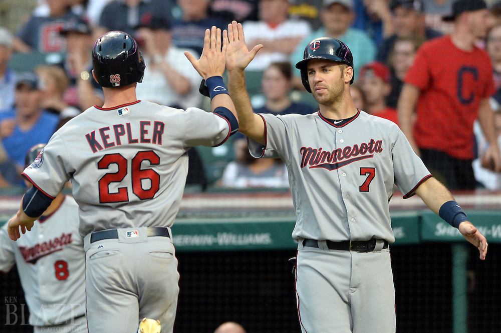 Aug 2, 2016; Cleveland, OH, USA; Minnesota Twins right fielder Max Kepler (26) and first baseman Joe Mauer (7) celebrate after scoring during the fourth inning against the Cleveland Indians at Progressive Field. Mandatory Credit: Ken Blaze-USA TODAY Sports