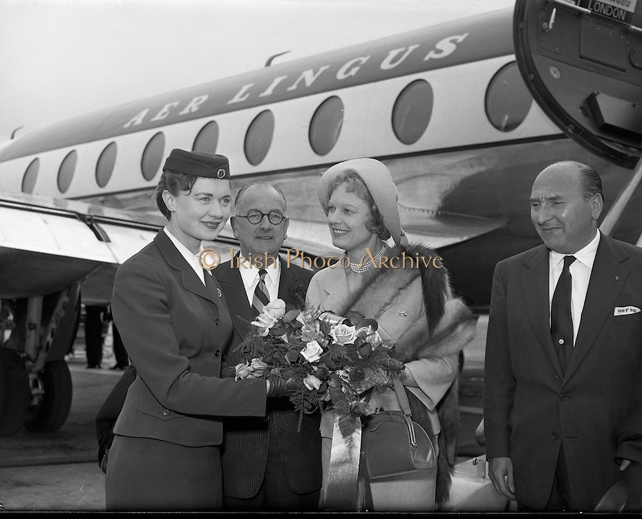 Herbert Wilcox and Anna Neagle arriving at Dublin Airport.08/06/1957..Dame Anna Neagle, DBE (20/10/1904 – 03/06/1986), born Florence Marjorie Robertson, was a popular British stage and motion picture actress and singer..Neagle proved to be a box-office sensation in British films for over 25 years. She was noted for providing glamour and sophistication to war-torn London audiences with her lightweight musicals, comedies and historical dramas. She won several awards as Britain's favourite actress and biggest female box-office draw. Almost all of her films were produced and directed by Herbert Wilcox, whom she married in 1943..In her historical dramas, Neagle was renowned for her portrayals of real-life British heroines, including Nell Gwynn (Nell Gwynn, 1934), Queen Victoria (Victoria the Great, 1937, and Sixty Glorious Years, 1938) and Edith Cavell (Nurse Edith Cavell, 1939)..