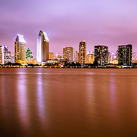 Photo of downtown San Diego skyline at night buildings along San Diego Bay. Photo is high resolution and was taken in 2012.