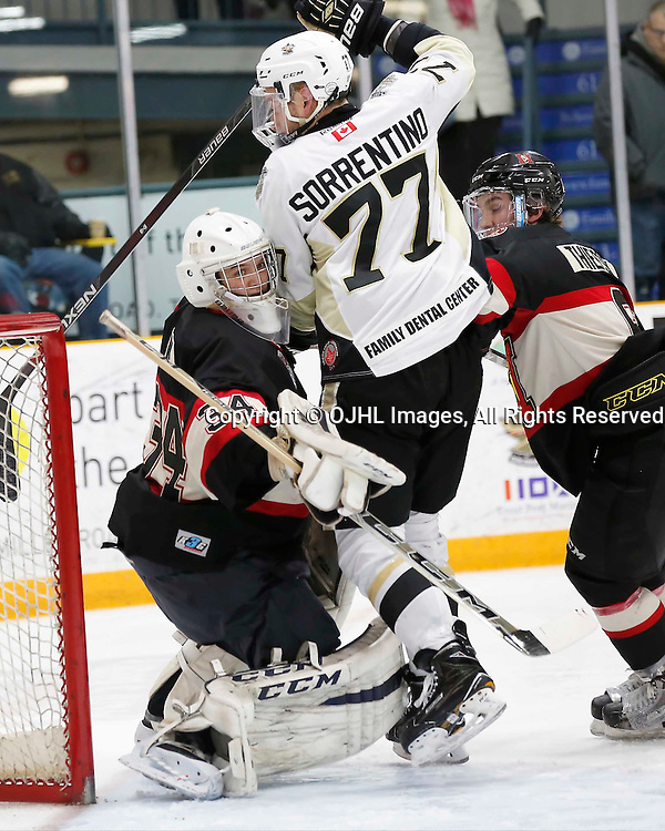 TRENTON, ON - MAR 3,  2017: Ontario Junior Hockey League, playoff game between the Trenton Golden Hawks and the Newmarket Hurricanes., Sorrentino #77 of the Trenton Golden Hawks collides with Kirk Fraser #34 of the Newmarket Hurricanes during the third period<br /> (Photo by Amy Deroche / OJHL Images)