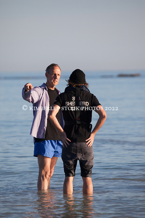 Ex senator Bob Brown chats with Steve Irwin's skipper Mal Holland on Broome's Cable Beach as visitors wait to board the vessel.