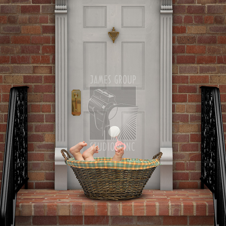 Baby in a basket on a doorstep
