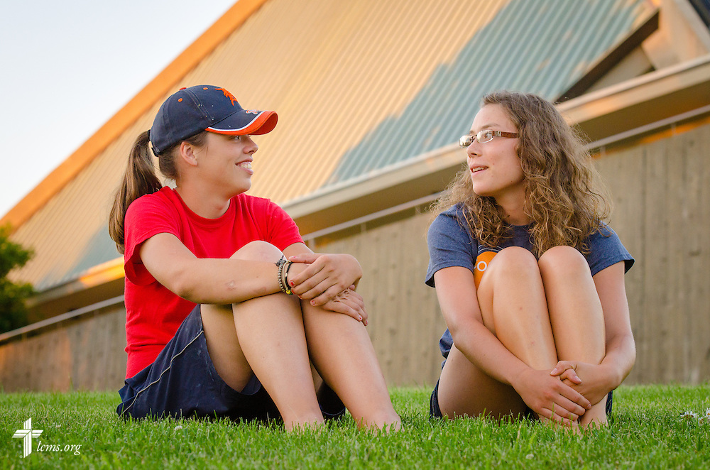Students Ivy Wollberg (left) and Meggan Muhle talk together during sunset at Concordia University Ann Arbor on Wednesday, July 2, 2014, in Ann Arbor, Mich. LCMS Communications/Erik M. Lunsford