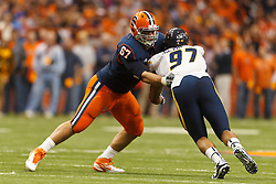 Oct 21, 2011; Syracuse NY, USA;  West Virginia Mountaineers defensive lineman Julian Miller (97) is blocked by Syracuse Orange offensive tackle Justin Pugh (67) during the fourth quarter at the Carrier Dome.  Syracuse defeated West Virginia 49-23. Mandatory Credit: Jason O. Watson-US PRESSWIRE