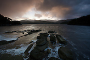 The sun sets over The North Arm of Paterson Inlet, Stewart Island, New Zealand