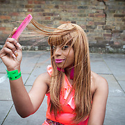 A carnival goer prepares for a day of dancing in the streets<br /> <br /> Unison