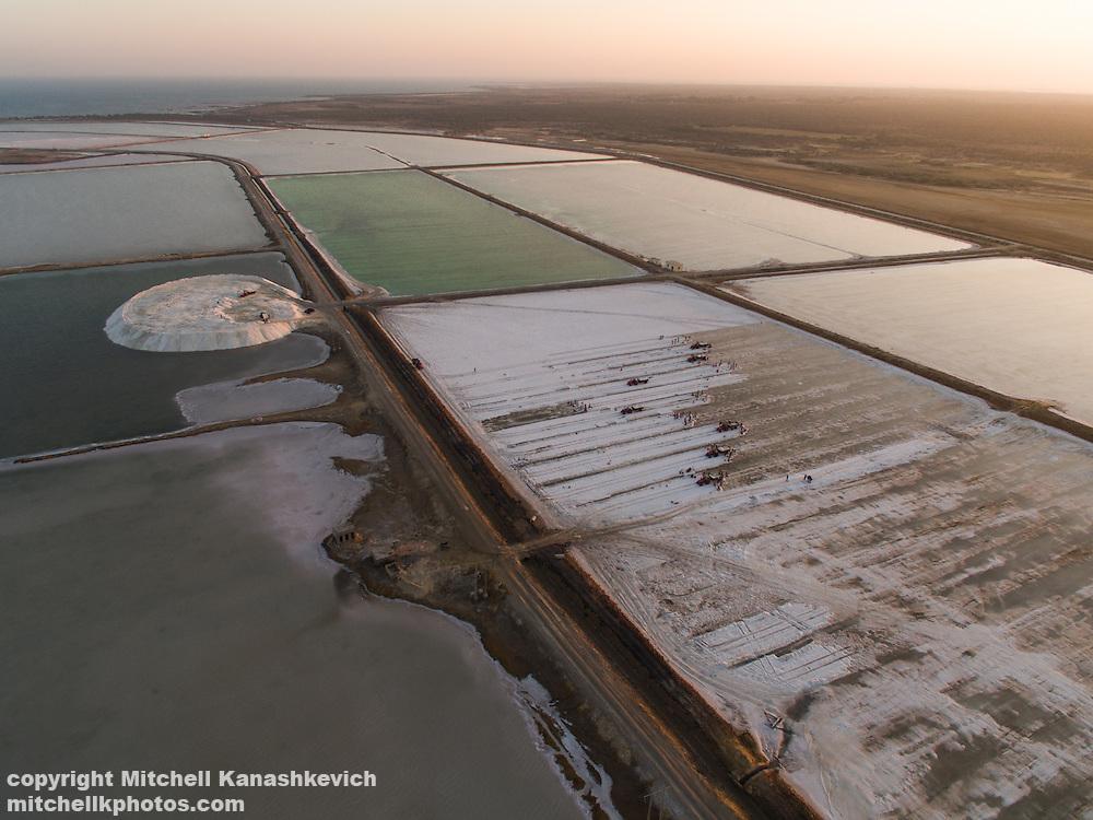 Aerial drone image of salt workers in salt pans near Dwarka, Gujarat, India.