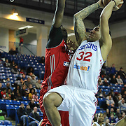 Delaware 87ers Forward Drew Gordon (32) drives towards the basket as Rio Grande Valley Vipers Forward Clint Capela (32) defends in the first half of a NBA D-league regular season basketball game between the Delaware 87ers and the Rio Grande Valley Vipers (Houston Rockets) Saturday, Dec. 27, 2014 at The Bob Carpenter Sports Convocation Center in Newark, DEL