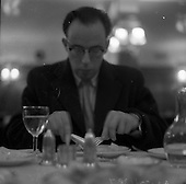 1959 Mr. Verealy wearing an  overcoat while eating in Wicklow Hotel Restaurant