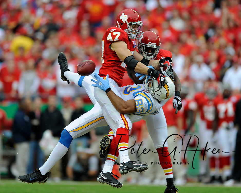 October 25, 2009:   Defenders Jon McGraw #47 and Brandon Flowers #24 of the Kansas City Chiefs brake up a pass intended for wide receiver Vincent Jackson #83 of the San Diego Chargers in the first quarter at Arrowhead Stadium in Kansas City, Missouri.  The Chargers defeated the Chiefs 37-7...