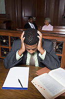Male solicitor working in court