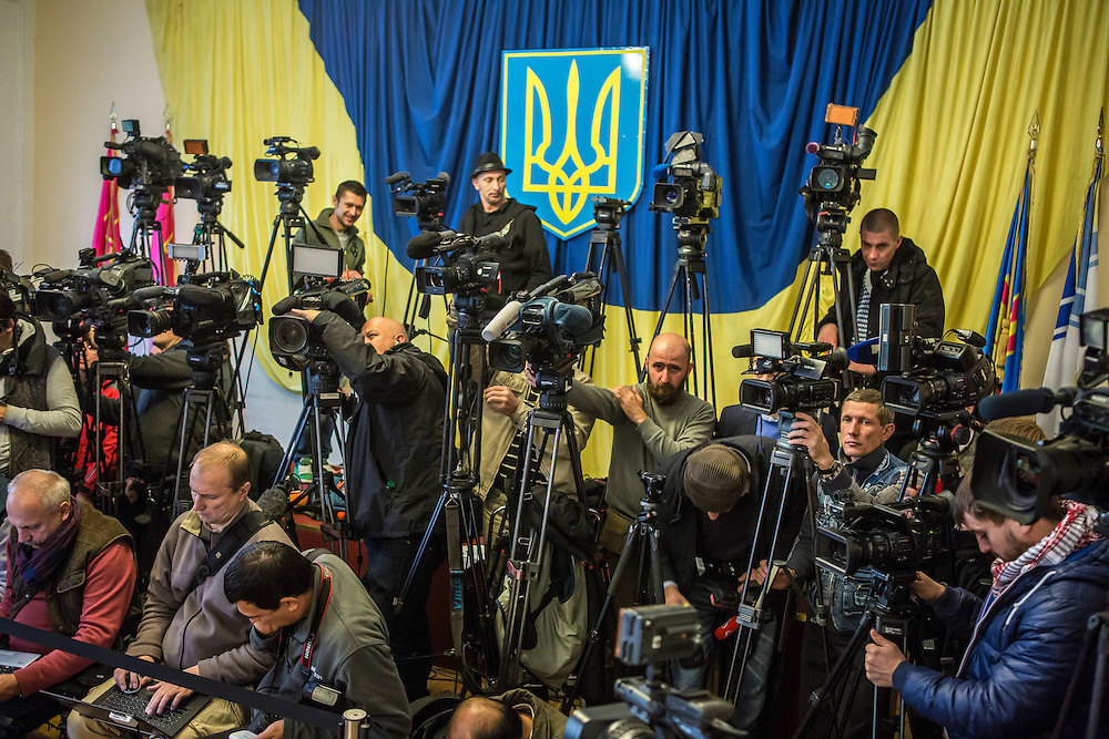 KIEV, UKRAINE - OCTOBER 26: Journalists wait for President Petro Poroshenko to cast his ballot in parliamentary elections on October 26, 2014 in Kiev, Ukraine. Although a low turnout is expected in the east of the country amid continued fighting between Ukrainian forces and pro-Russian separatists, Ukraine is expected to elect a pro-Western parliament in a further move away from Russian influence. (Photo by Brendan Hoffman/Getty Images) *** Local Caption ***