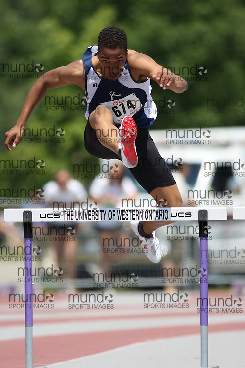 (London, Ontario---14/06/09)   Ingvar Moseley of Project Athletics T.F.C. competes in the  400m hurdles at the 2009 Athletics Ontario Junior Track and Field Championships. The meet was held in London, Ontario from June 13-14, 2009. Copyright photograph Sean Burges / Mundo Sport Images, 2009. www.mundosportimages.com / www.msievents.