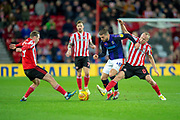 Aiden McGeady (#19) of Sunderland AFC and Dylan McGeouch (#8) of Sunderland AFC tackle Elliot Lee (#10) of Luton Town FC during the EFL Sky Bet League 1 match between Sunderland AFC and Luton Town at the Stadium Of Light, Sunderland, England on 12 January 2019.
