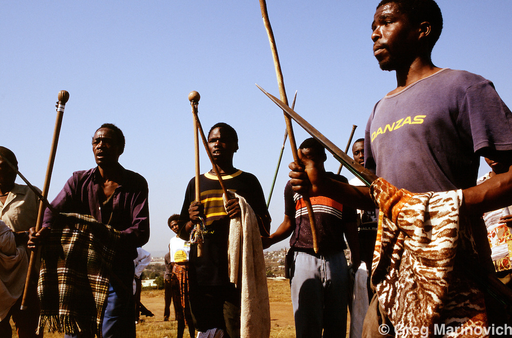 Xhosa ANC supporting warriors prepare for battle  in Bekkersdal, west of Johannesburg, South Africa, 1994.