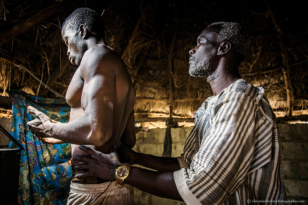 April 1 2016. A shaman in prepares a wrestler for a fight in Djilass, a small village on the countryside in the district of Thiès. Even well reknown wrestlers from Dakar somtimes visit the marabouts in the small villages on the countryside, because they believe that every Marabout has his own supernatural skills and magic powers.