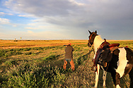 John Zeman takes aim at rising sharptails during a Montana horseback grouse hunt.