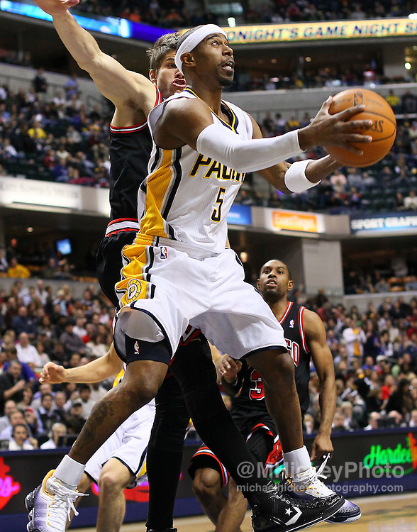 Jan. 14, 2011; Indianapolis, IN, USA; Indiana Pacers guard TJ Ford (5) puts up a reverse layup against the Chicago Bulls at Conseco Fieldhouse. Mandatory credit: Michael Hickey-US PRESSWIRE