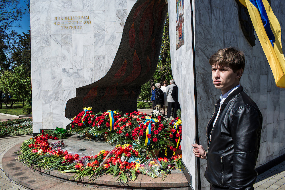 DONETSK, UKRAINE - APRIL 25:  A man holds a Ukrainian flag during a memorial service commemorating the anniversary of the 1986 Chernobyl nuclear accident on April 25, 2014 in Donetsk, Ukraine. The accident, which took place in the northern part of Ukraine, is considered the worst nuclear accident in history. (Photo by Brendan Hoffman/Getty Images) *** Local Caption ***